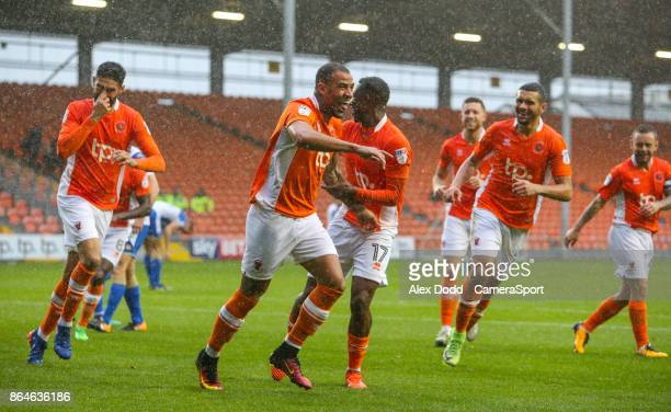 Blackpool's Kyle Vassell celebrates scoring his side's first goal with teammates during the Sky Bet League One match between Blackpool and Wigan...