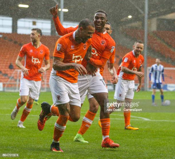 Blackpool's Kyle Vassell celebrates scoring his side's first goal with teammate Viv SolomonOtabor during the Sky Bet League One match between...