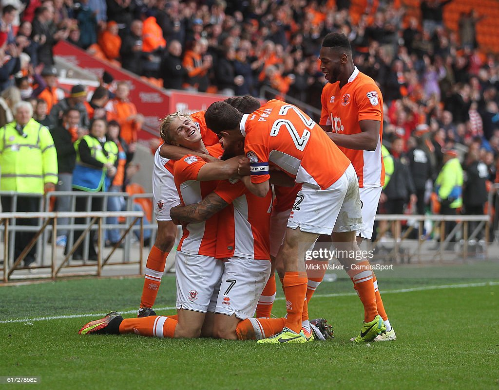 Blackpool's Kyle Vassell celebrates scoring his sides fourth goal with his team mates during the Sky Bet League Two match between Blackpool and Doncaster Rovers at Bloomfield Road on October 22, 2016 in Blackpool, England.