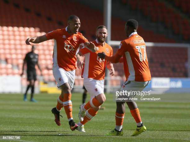 Blackpool's Kyle Vassell celebrates scoring the opening goal with teammates Viv SolomonOtabor and Jimmy Ryan during the Sky Bet League One match...