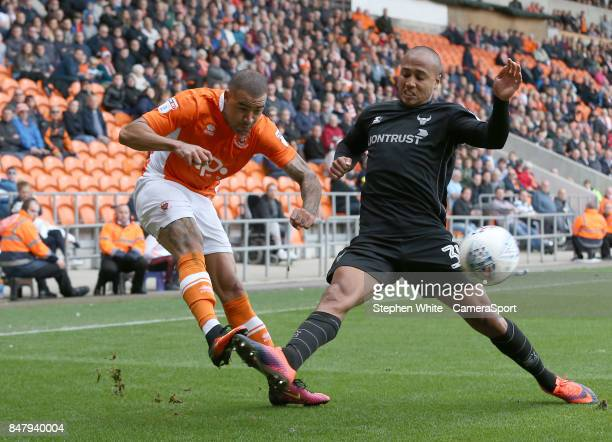 Blackpool's Kyle Vassell crosses the ball despite the attentions of Oxford United's Gino van Kessel during the Sky Bet League One match between...