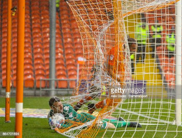 Blackpool's Kyle Vassell gets caught in the net after opening the scoring during the Sky Bet League One match between Blackpool and Wigan Athletic at...