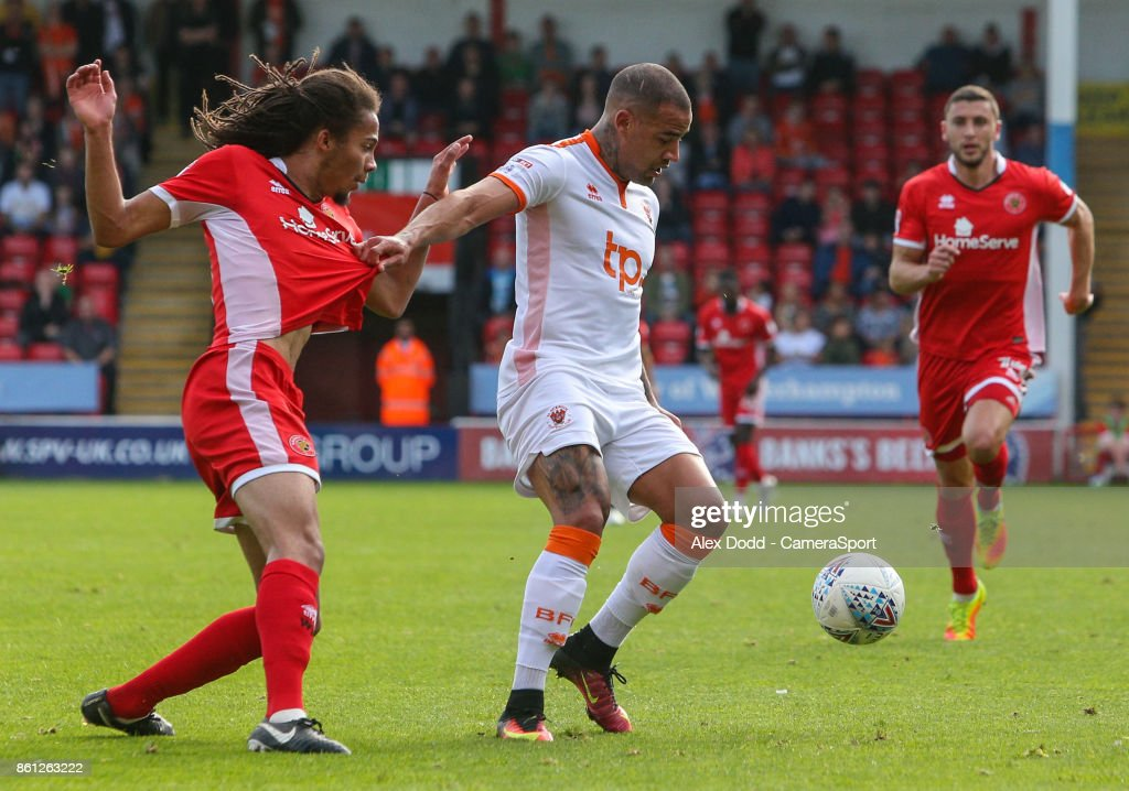 Blackpool's Kyle Vassell holds off the challenge from Walsall's Kory Roberts during the Sky Bet League One match between Walsall and Blackpool at Banks' Stadium on October 14, 2017 in Walsall, England.