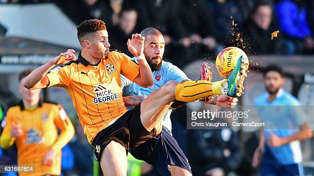 Blackpool's Kyle Vassell is tackled by Cambridge United's Jake Carroll during the Sky Bet League Two match between Cambridge United and Blackpool at...