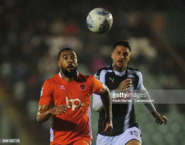 Blackpool's Kyle Vassell under pressure from Plymouth Argyle's Sonny Bradley during the Sky Bet League One match between Plymouth Argyle and...