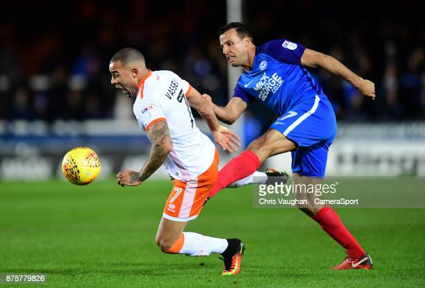 Blackpool's Kyle Vassell vies for possession with Peterborough United's Steven Taylor during the Sky Bet League One match between Peterborough United...