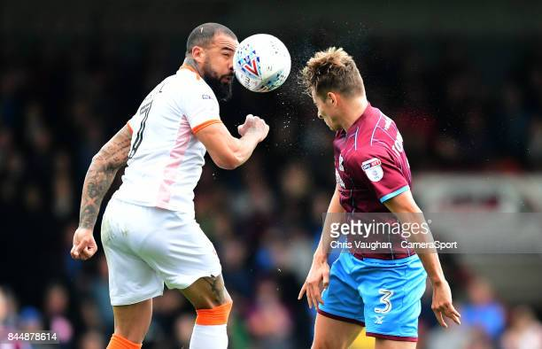 Blackpool's Kyle Vassell vies for possession with Scunthorpe United's Conor Townsend during the Sky Bet League One match between Scunthorpe United...