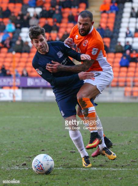 Blackpool's Kyle Vassell vies for possession with Southend United's Michael Timlin during the Sky Bet League One match between Blackpool and Southend...