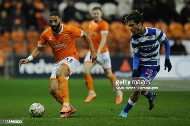 Blackpool's Liam Feeney under pressure from Reading's Danny Loader during the FA Cup Third Round Replay match between Blackpool and Reading at...