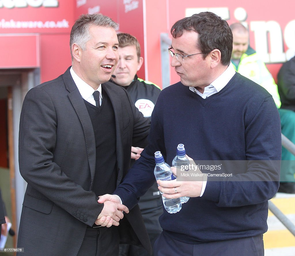 Blackpool's Manager Gary Bowyer greets Doncaster Rovers' Manager Brad Potts Darren Ferguson during the Sky Bet League Two match between Blackpool and Doncaster Rovers at Bloomfield Road on October 22, 2016 in Blackpool, England.