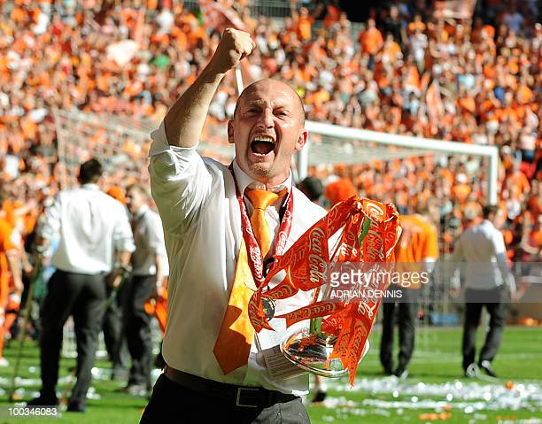 Blackpool's manager Ian Holloway celebrates with the trophy after his team beat Cardiff City during the 2010 Championship playoff final football...