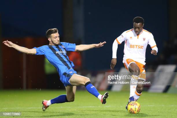 Blackpool's Marc Bola and Gillingham's Luke O'Neill during the Sky Bet League One match between Gillingham and Blackpool at Priestfield Stadium on...