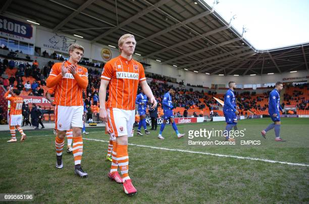 Blackpool's Mark Cullen and Brad Potts make their way out on to the pitch prior to kickoff