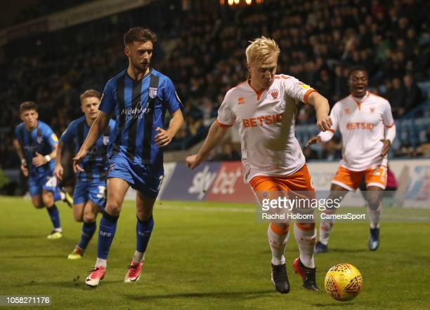Blackpool's Mark Cullen and Gillingham's Luke O'Neill during the Sky Bet League One match between Gillingham and Blackpool at Priestfield Stadium on...