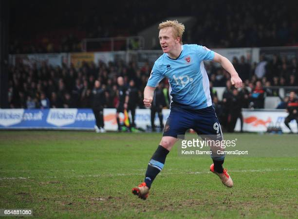 Blackpool's Mark Cullen celebrates scoring his sides second goal during the Sky Bet League Two match between Newport County and Blackpool at Rodney...
