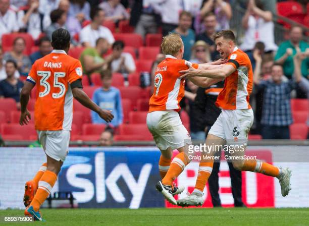 Blackpool's Mark Cullen celebrates scoring his sides second goal with team mate Will Aimson during the EFL Sky Bet League Two PlayOff Final match...