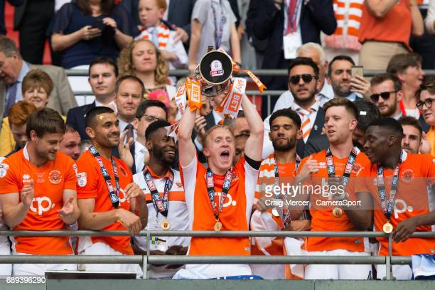 Blackpool's Mark Cullen celebrates with the winners trophy during the EFL Sky Bet League Two PlayOff Final match between Blackpool and Exeter City at...