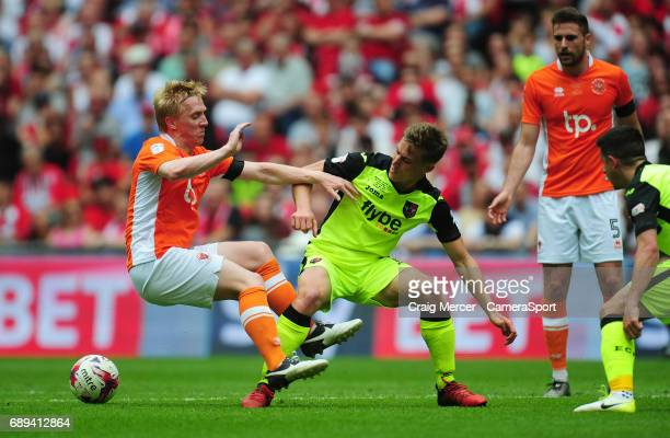 Blackpool's Mark Cullen is fouled by Exeter City's David Wheeler during the EFL Sky Bet League Two PlayOff Final match between Blackpool and Exeter...