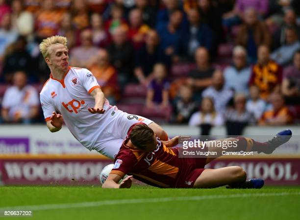 Blackpool's Mark Cullen is tackled by Bradford City's Matthew Kilgallon during the Sky Bet League One match between Bradford City and Blackpool at...