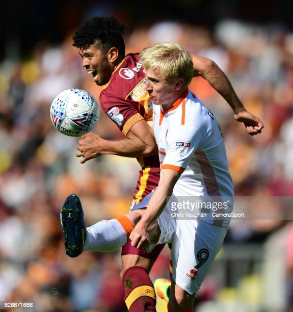 Blackpool's Mark Cullen vies for possession with Bradford City's Nat KnightPercival during the Sky Bet League One match between Bradford City and...