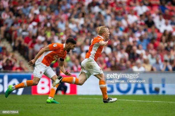 Blackpool's Mark Cullen wheels away to celebrate scoring his sides second goal during the EFL Sky Bet League Two PlayOff Final match between...