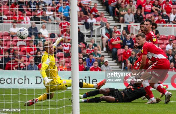 Blackpool's Marvin Ekpiteta scores his side's equalising goal to make the score 1-1 during the Sky Bet Championship match between Middlesbrough and...