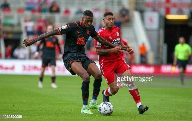 Blackpool's Marvin Ekpiteta tackles Middlesbrough's Onel Hernández during the Sky Bet Championship match between Middlesbrough and Blackpool at the...