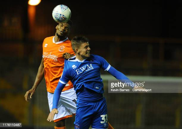 Blackpool's Michael Nottingham under pressure from Carlisle United's Elias Sorensen during the EFL Leasingcom Trophy Northern Section Group G match...