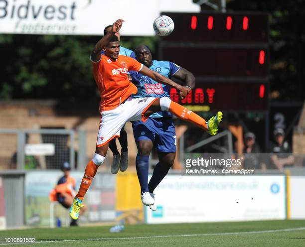 Blackpool's Michael Nottingham vies for possession with Wycombe Wanderers' Adebayo Akinfenwa during the Sky Bet League One match between Wycombe...