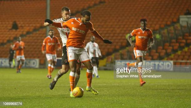 Blackpool's Nathan Delfouneso avoids the challenge from Charlton Athletic's Jason Pearce before shooting and scoring his sides second goal during the...