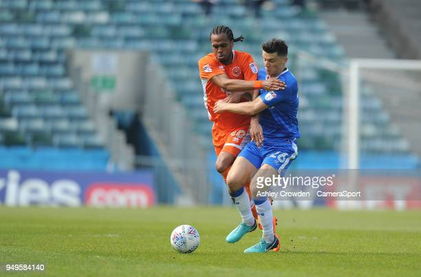Blackpool's Nathan Delfouneso battles with Gillingham's Callum Reilly during the Sky Bet League One match between Gillingham and Blackpool at...
