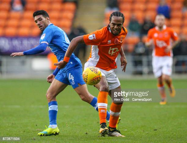 Blackpool's Nathan Delfouneso battles with Portsmouth's Danny Rose during the Sky Bet League One match between Blackpool and Wigan Athletic at...