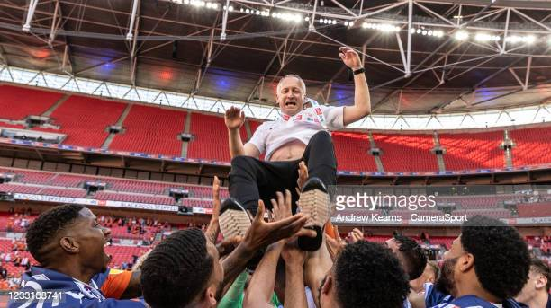 Blackpool's Neil Critchley gets the bumps from his players during the Sky Bet League One Play-off Final match between Blackpool and Lincoln City at...