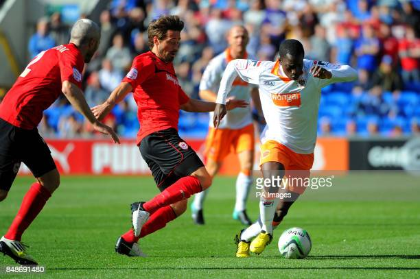 Blackpool's Nouha Dicko tries to get past Kevin McNaughton and Tommy Smith during the npower Football League Championship match at the Cardiff City...
