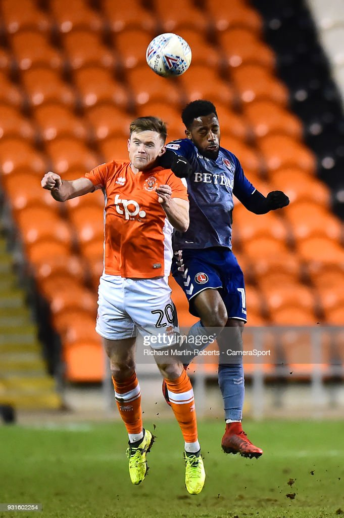 Blackpool's Oliver Turton competes in the air with Charlton Athletic's Tariqe Fosu during the Sky Bet League One match between Blackpool and Charlton Athletic at Bloomfield Road on March 12, 2018 in Blackpool, England.