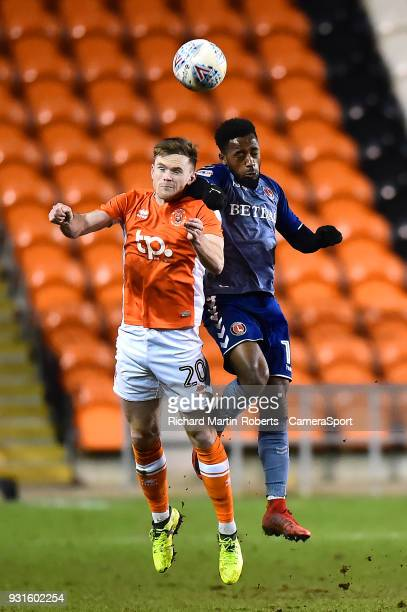 Blackpool's Oliver Turton competes in the air with Charlton Athletic's Tariqe Fosu during the Sky Bet League One match between Blackpool and Charlton...