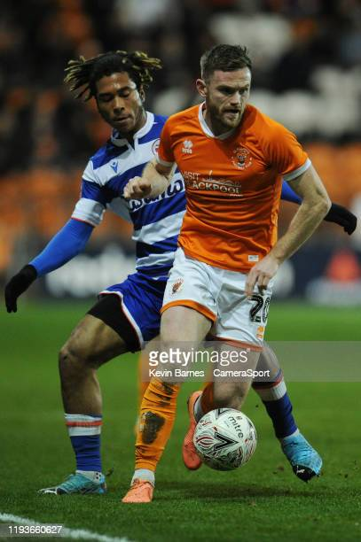 Blackpool's Oliver Turton under pressure from Reading's Danny Loader during the FA Cup Third Round Replay match between Blackpool and Reading at...