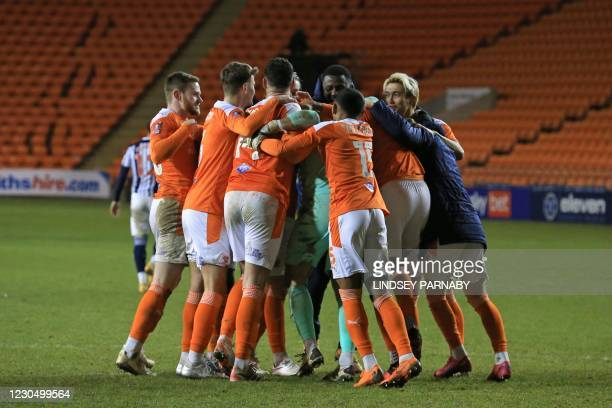 Blackpool's players celebrate on the pitch after winning the shoot-out in the English FA Cup third round football match between Blackpool and West...