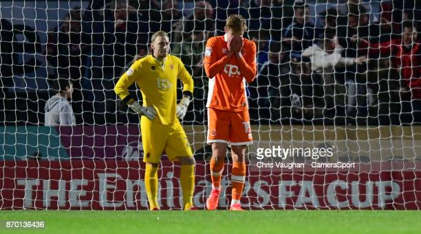 Blackpool's Ryan Allsop left and Blackpool's Sean Longstaff react after Boreham Wood's Dan Holman scored his sides second goal during the Emirates FA...