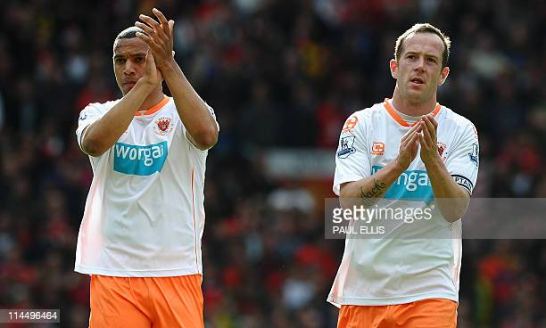 Blackpool's Scottish midfielder Charlie Adam and Blackpool's English midfielder Matt Phillips applaud the fans after the English Premier League...