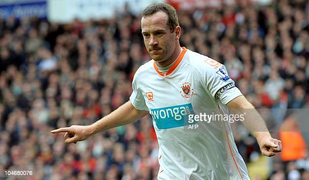 Blackpool's Scottish midfielder Charlie Adam celebrates after scoring the first goal from the penalty spot during his team's English Premier League...