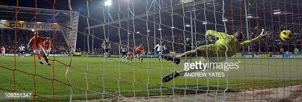 Blackpool's Scottish midfielder Charlie Adam scores his side's first goal during the English Premier League football match against Tottenham at...