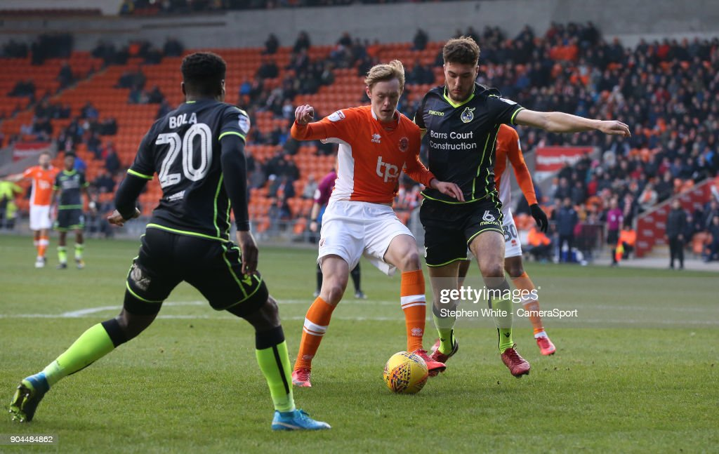 Blackpool's Sean Longstaff battles with Bristol Rovers' Ryan Sweeney (left) and Marc Bola during the Sky Bet League One match between Blackpool and Bristol Rovers at Bloomfield Road on January 13, 2018 in Blackpool, England.