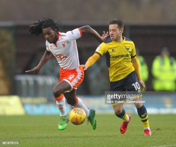 Blackpool's Sessi D'Almeida battles with Oxford United's Jack Payne during the Sky Bet League One match between Oxford United and Blackpool at Kassam...