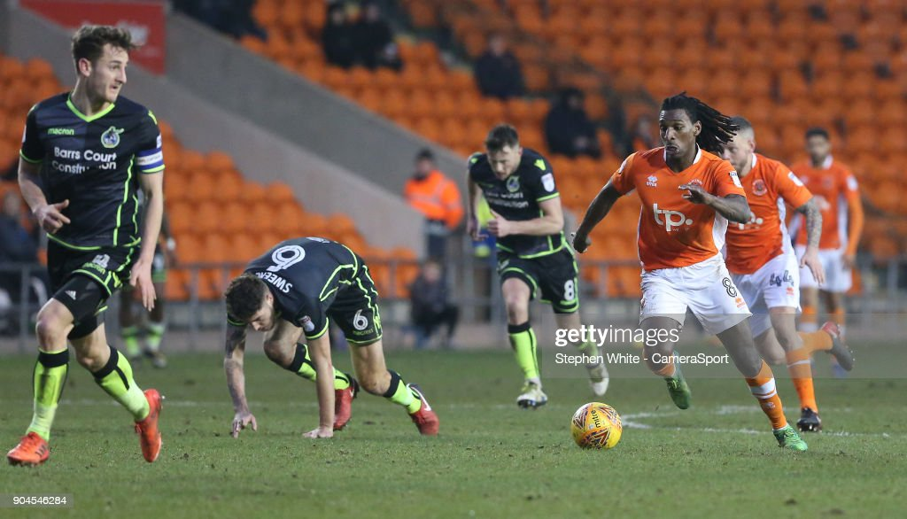 Blackpool's Sessi D'Almeida gets away from Bristol Rovers' Ryan Sweeney during the Sky Bet League One match between Blackpool and Bristol Rovers at Bloomfield Road on January 13, 2018 in Blackpool, England.