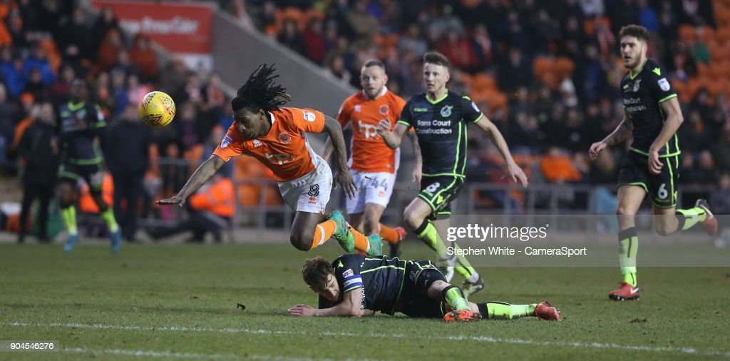 Blackpool's Sessi D'Almeida is tackled by Bristol Rovers' Tom Lockyer during the Sky Bet League One match between Blackpool and Bristol Rovers at Bloomfield Road on January 13, 2018 in Blackpool, England.