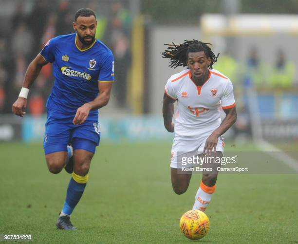 Blackpool's Sessi D'Almeida under pressure from AFC Wimbledon's Tom Soares during the Sky Bet League One match between AFC Wimbledon and Blackpool at...