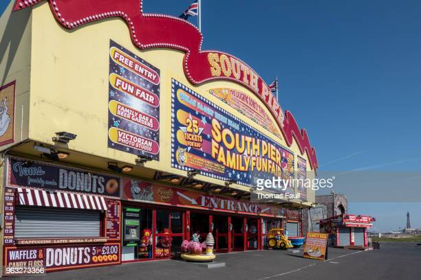 blackpool's south pier on the promenade - blackpool stock photos and pictures