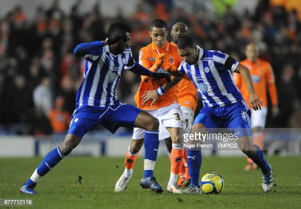 Blackpool's Thomas Ince is sandwiched between Sheffield Wednesday's Reda Johnson and Julian Bennett