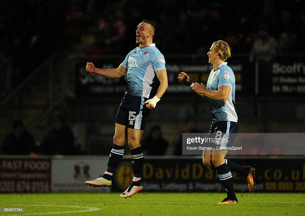 Blackpool's Tom Aldred (left) celebrates scoring his sides first goal with team-mate Brad Potts during the Sky Bet League Two match between Leyton Orient and Blackpool at Brisbane Road on November 19, 2016 in London, England.